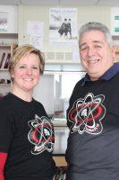 Coaches Lucinda Nolan and Gene Madsen model the shirt dedicated to Peter Koval