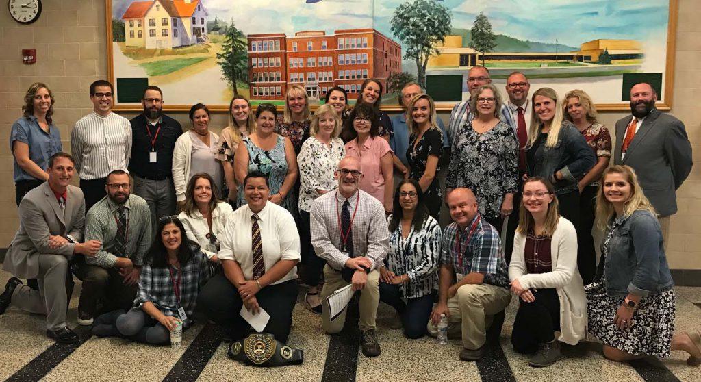 A group photo of high school teachers