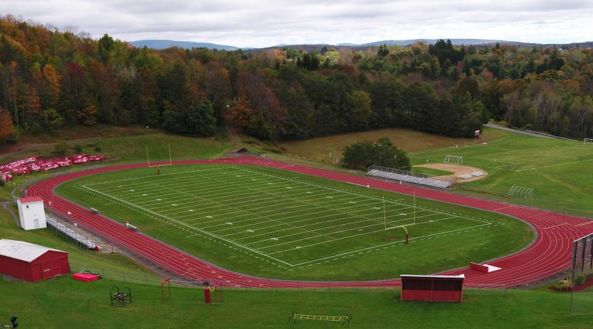 An ariel view of a football field surrounded by a track
